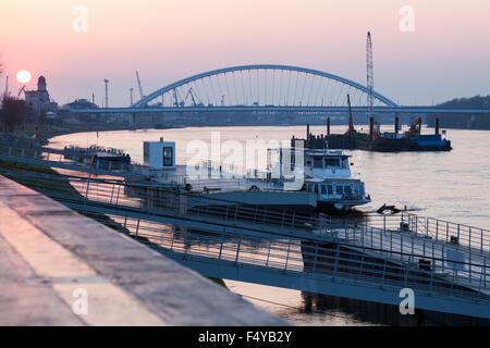 Apollo Bridge on Danube River at sunrise - Stock Photo