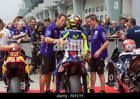 Sepang Circuit, Malaysia. 24th  Oct, 2015. Valentino Rossi is congratulated in the Parc Ferme after qualifying for - Stock Photo