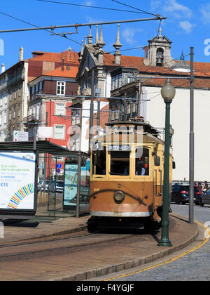 Historic tram on line 1 (one) Passeio Alegre�Infante coming round a bend on Rua Nova da Alf�ndega Porto (Oporto) - Stock Photo