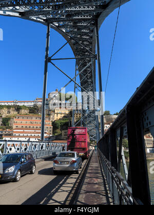 Road traffic crossing the double-decked Ponte Luis 1 bridge and the light rail trestle overhead. - Stock Photo