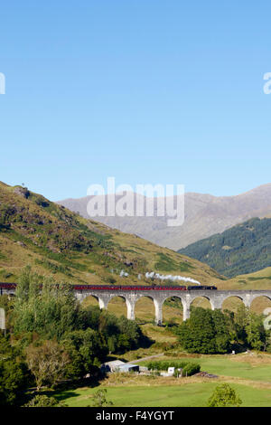 The Jacobite steam train passing over the Glenfinnan Viaduct. - Stock Photo