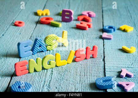 English is easy to learning concept with letters on blue boards concept - Stock Photo