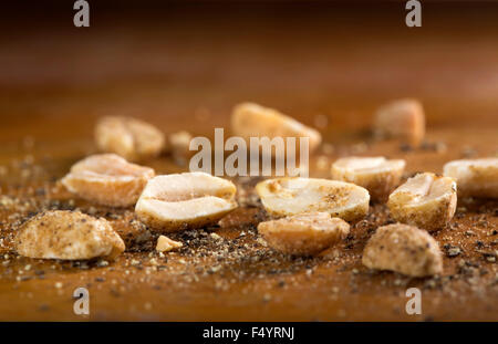 Peanuts. Close up of fried, peeled, salted peanuts with pepper - Stock Photo
