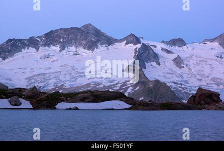 Schwarzsee lake in Zemmgrund, Ginzling behind, sunrise, Zillertal, Tyrol, Austria - Stock Photo