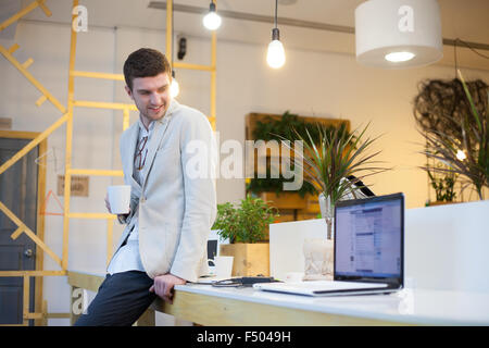 Programmer have coffee break in office - Stock Photo