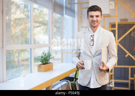 Happy worker in workplace - Stock Photo