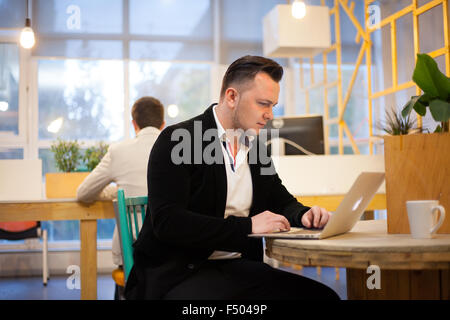 Coder working in office - Stock Photo