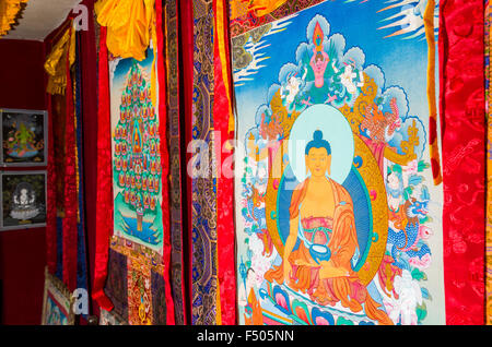 Pile of small Thangkas for sale in one of the art schools near Boudnath Stupa - Stock Photo