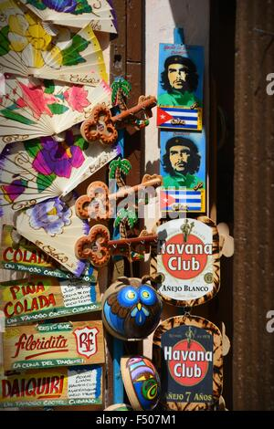 cheap gifts and souvenirs from Havana Cuba; fridge magnets, images of Che Guevara and the Cuban flag, hand painted - Stock Photo