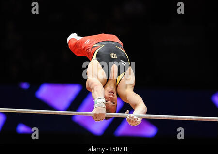 FABIAN HAMBUECHEN from Germany competes on the high bar during the preliminary round of the 2015 World Gymnastics - Stock Photo