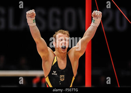 FABIAN HAMBUECHEN from Germany celebrates after high bar routine during the preliminary round of the 2015 World - Stock Photo
