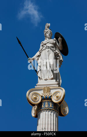 Marble statue of Greek deity Athena / Pallas Athene holding a shield and spear against blue sky. Panepistimiou str. - Stock Photo
