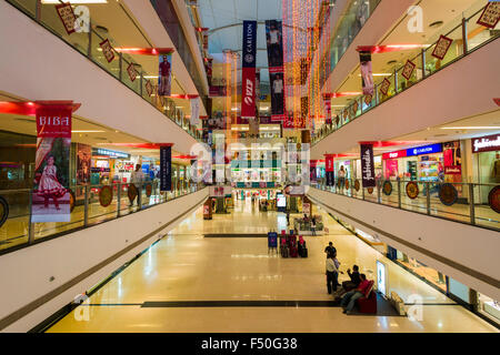 The main hall of the modern shopping mall Gulmohar Park with four floors and many shops - Stock Photo