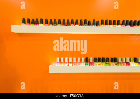 Nail polish is displayed for sale in one of the shops of the modern shopping mall Gulmohar Park - Stock Photo