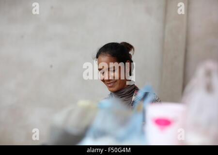 Portrait of Asian woman smiling - Stock Photo