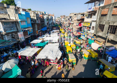A crowded street with shops and traffic jam in the old city market area - Stock Photo
