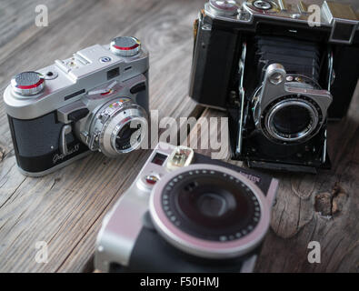 A collection of vintage and retro looking film cameras - Stock Photo