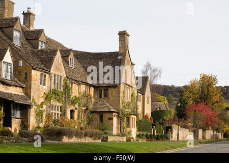 Cotswold stone houses in the Autumn sunshine. - Stock Photo