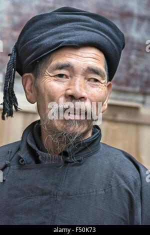 Elderly Miao man in traditional attire, Langde Shang Miao Village, Guizhou Province, China - Stock Photo