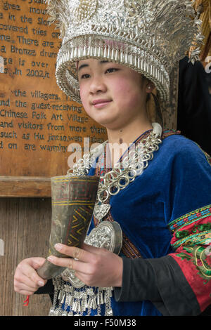 Welcom horn of rice, Miao woman in traditional attire, Langde Shang Miao Village, Guizhou Province, China - Stock Photo