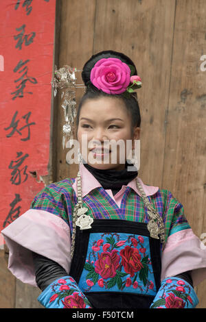 Portrait of a Green Medium Skirt Miao woman, Shiqiao Village, Guizhou Province, China - Stock Photo