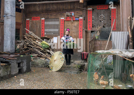 Woman in Green Medium Skirt Miao village, Shiqiao, Guizhou Province, China - Stock Photo
