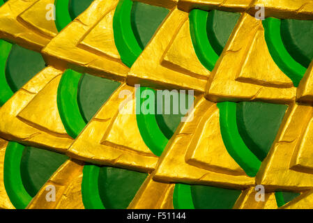 detail of a golden and green naga for background. - Stock Photo