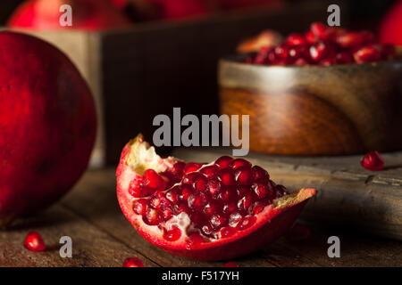 Raw Organic Red Pomegranates Ready to Eat Stock Photo