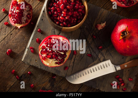 Raw Organic Red Pomegranates Ready to Eat - Stock Photo