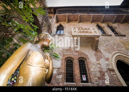 The brass statue of Juliet in the backyard of Juliets house with the famous balcony - Stock Photo
