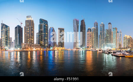 Skyline of skyscrapers  at night in  Marina district of Dubai United Arab Emirates - Stock Photo
