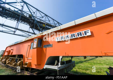 An orange Track Moving Machine of the company Takraf, used in brown coal opencast mining to shift railway tracks, - Stock Photo