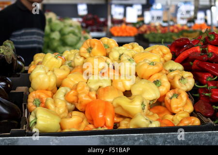 Yellow orange capsicums for sale at Dandenong Market, Melbourne, VIctoria Australia - Stock Photo