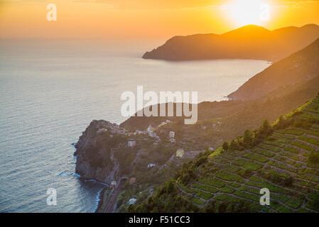 Sunset over Corniglia, Cinque Terre National Park, Province of La Spezia, Liguria, Italy, EU, Europe - Stock Photo
