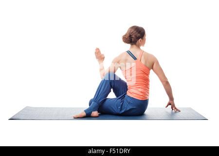 Sporty fit yogini woman practices yoga asana - Stock Photo