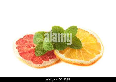 Mint on yellow orange and blood, red grape. on isolated white background - Stock Photo