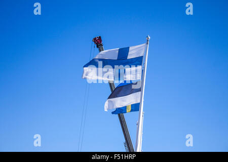 Finnish flag, in front of estonian and swedish flag - Stock Photo