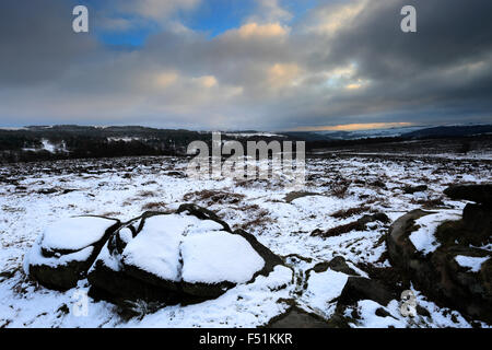 January, winter snow view, gritstone rocks on Lawrence Field, Grindleford village, Derbyshire County; Peak District - Stock Photo