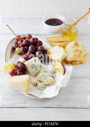 breakfast composition with cheese and grapes, food closeup - Stock Photo