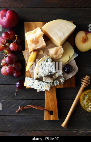 mix cheeses on rustic boards, food - Stock Photo