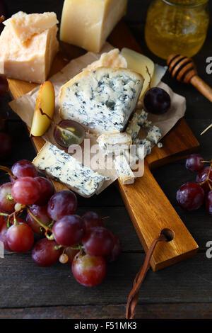 fresh grapes and blue cheese, food closeup - Stock Photo