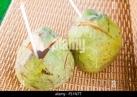Two green coconut drinks with straws, in Vietnam - Stock Photo