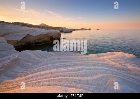 Coastal scenery with pale volcanic rocks near Sarakiniko beach in Milos island, Greece. - Stock Photo
