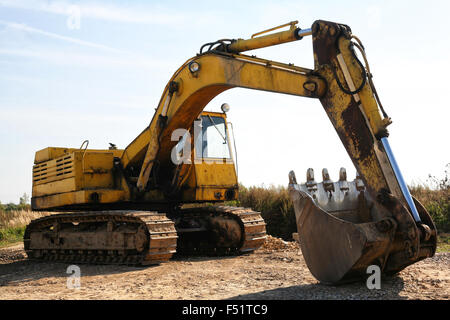 Large Front Loader Digger Working In A Quarry Lake