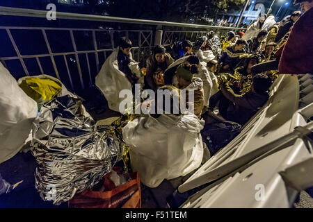 Passau, Germany. 25th Oct, 2015. Refugees wait on Innbruecke bridge at the Austrian-German border between Simbach - Stock Photo