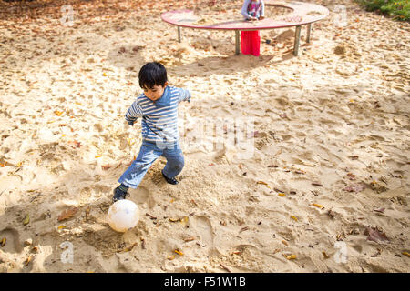 Gelsenkirchen, Germany. 26th Oct, 2015. A child from Romania playing football in Gelsenkirchen, Germany, 26 October - Stock Photo
