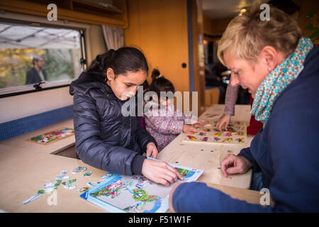 Gelsenkirchen, Germany. 26th Oct, 2015. A girl playing in the mobile home daycare centre in Gelsenkirchen, Germany, - Stock Photo