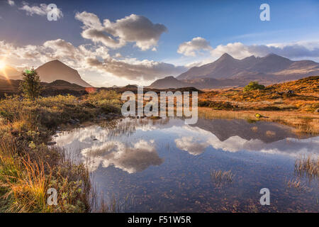 The Cuillins, autumn, at sunrise, reflected in a pool of water, Isle of Skye, Inner Hebrides, Highland, Scotland, - Stock Photo