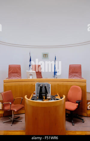 Judge's chairs in an empty courtroom inside the Supreme Court of Israel building in West Jerusalem, Israel - Stock Photo