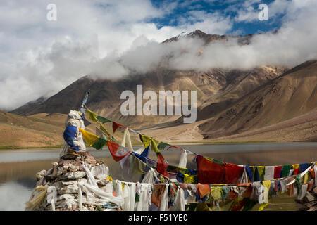 India, Himachal Pradesh, Spiti, Chandra Taal, Full Moon Lake, prayer flags in early morning light - Stock Photo